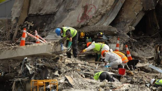 Search and rescue teams scour the wreckage of the CTV building in Christchurch.