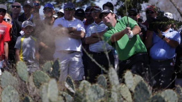 Steven Bowditch hits out of trouble on the second hole.