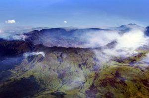 The crater of Indonesia's Mount Tambora. Its eruption in 1815 was the largest in recorded history. Its volcanic ash and ...