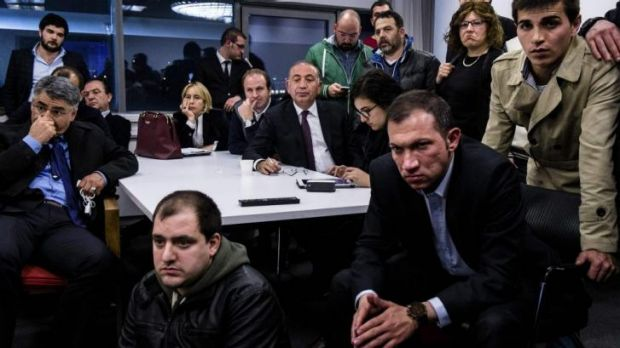 Grim tidings: Members of the opposition Republican People's Party (CHP) watch the election results from their Ankara HQ.