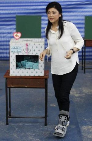 Hobbling on: Thai Prime Minister Yingluck Shinawatra casts her ballot in Senate elections on Sunday, but faces possible ...