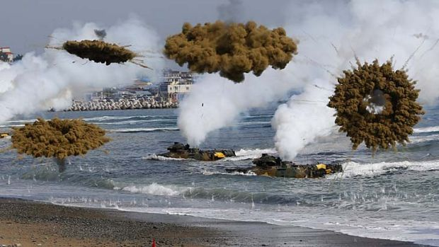 Amphibious assault vehicles of the South Korean Marine Corps throw smoke bombs during a US-South Korea joint landing ...
