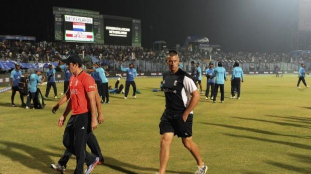Coach Ashley Giles trudges off after England's humiliating loss to the Netherlands.