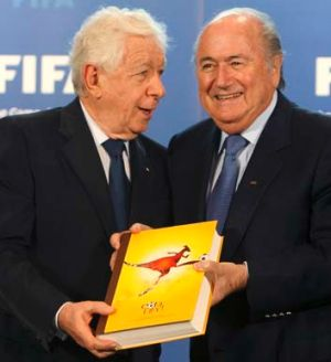 FFA chairman Frank Lowy submits Australia's official bid book for the 2018 or 2022 World Cups to FIFA president Sepp ...