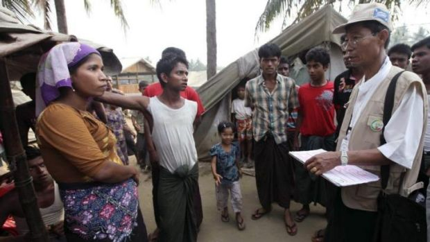 A census taker (right) talks to members of the Rohingya ethnic group in Myanmar's Rakhine state on April 1. The Myanmar ...