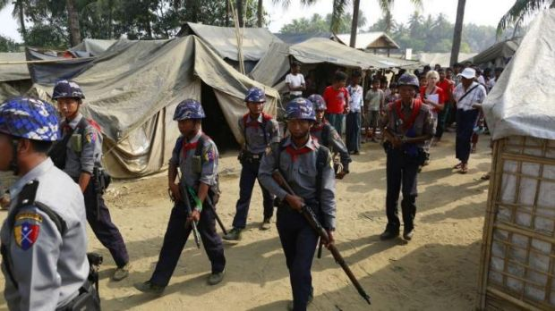 Police arrive in a refugee camp for internally displaced Rohingyas in Myanmar's Rakhine state ahead of the controversial ...