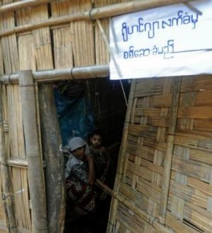 """A notice on the outside of a Rohingya home in Myanmar's Rakhine state reads """"will accept (census) check if (you) accept ..."""