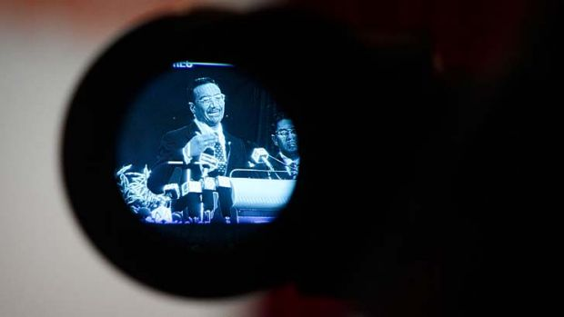 Life through a lens: Hishammuddin Hussein is filmed during a press conference.