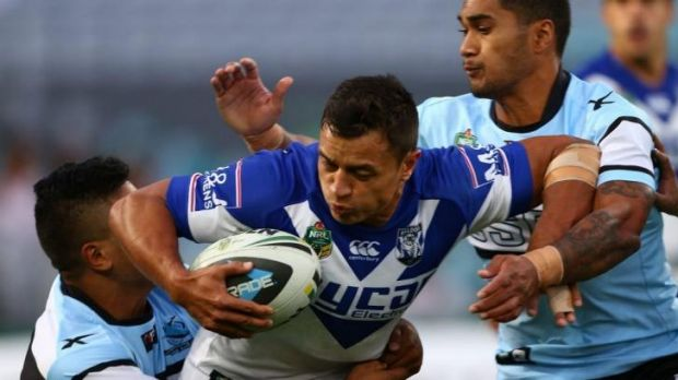 New home: Sam Perrett takes on the Cronulla defence.