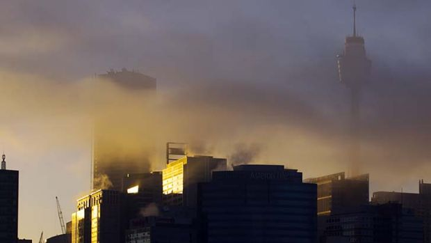 Clouding the issue: The city centre at sunrise on Wednesday morning.