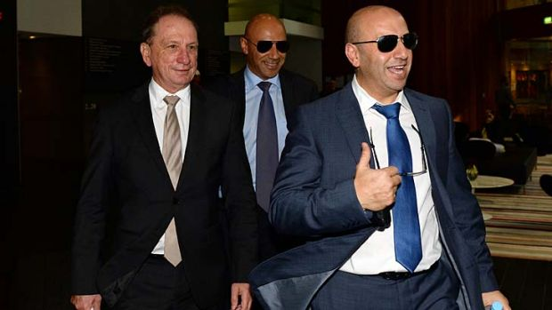 Questioned: Moses Obeid, centre, with brother Paul, right, and lawyer Michael Bowe leaving the inquiry.
