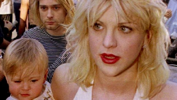 Musical of their life ... Courtney Love with Kurt Cobain, holding their daughter Frances Bean Cobain, in 1992.