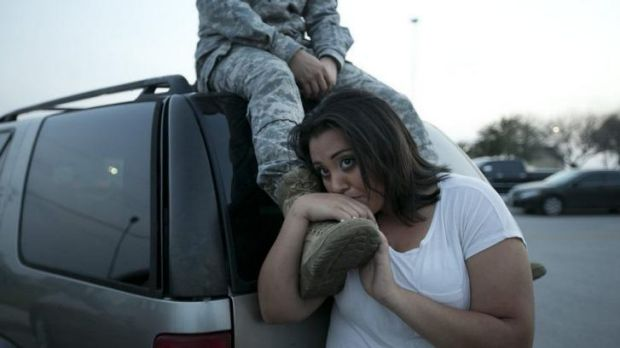 Luci Hamlin and her husband Specialist Timothy Hamlin wait to return to their home on the base at Fort Hood, Texas, ...