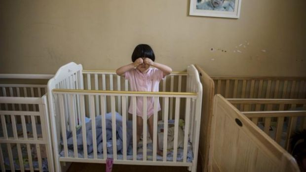 An orphaned Chinese girl in a foster care centre in Beijing.