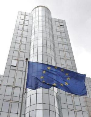 The European Union flag flies in front of the European Parliament in Brussels.