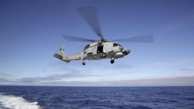A S-70B-2 Seahawk launches from HMAS Toowoomba as it continues the search in the southern Indian Ocean for the missing ...