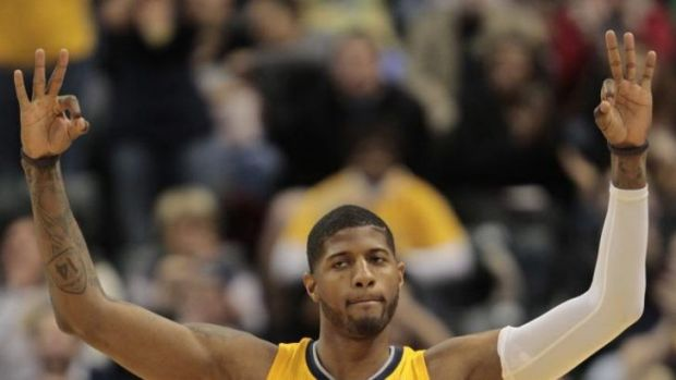 Indiana Pacers forward Paul George reacts after hitting a three-point shot against the Detroit Pistons in Indianapolis.