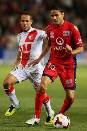 Marcelo Carrusca of Adelaide gets away from Massimo Murdocca of Melbourne Heart.
