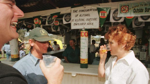 Pauline Hanson drinks with locals at the annual Linville Picnic Races.