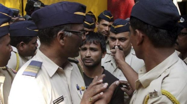 Death penalty ... Police escort one of the four men on gang-rape charges to a court in Mumbai, India.