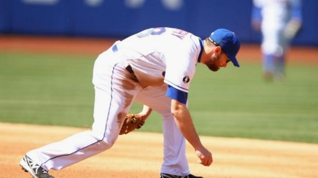 Daniel Murphy of the New York Mets commits an error is his side's loss to the Washington Nationals.