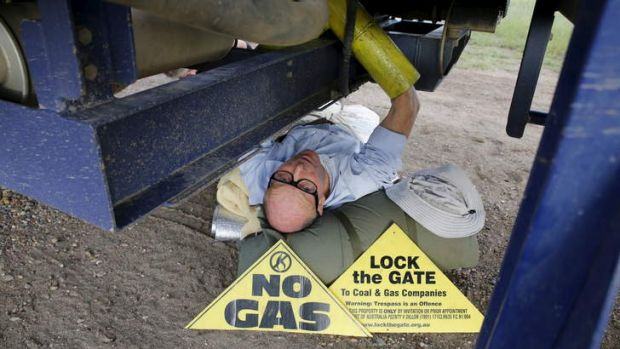 Simon Pockley, 64, locked under a Santos CSG rig truck headed towards the Pilliga forest. He's in Bellata. Photo: Supplied.