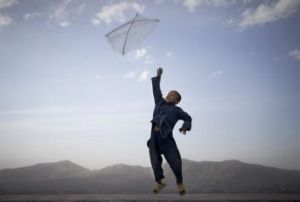 Body of work: An Afghan boy flies his kite on a hill overlooking Kabul, Afghanistan.