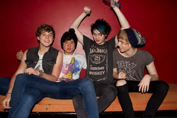 Members of 5 Seconds of Summer, Ashton Irwin, Calum Hood, Michael Clifford and Luke Hemmings after a performance at the ...