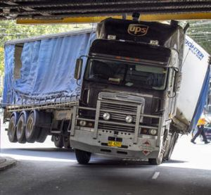Well wedged: a truck stuck in the corner of Flinders and Spencer Streets.
