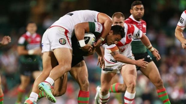 Souths forward Ben Te'o carries a Dragons defender at the SCG.