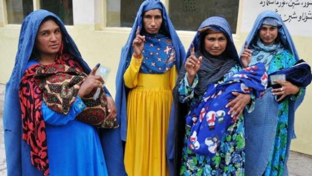 Afghan women show their inked fingers after they cast their vote in Jalalabad.