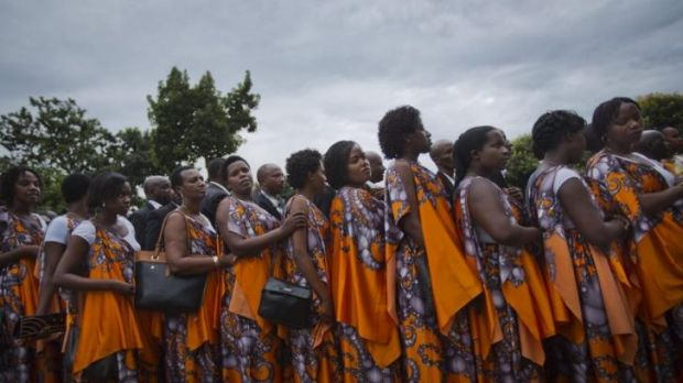 Rwandan women arrive in Kigali to take part in a procession following a small flame of remembrance, with the symbolic ...