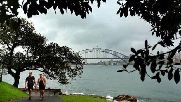 A couple walk through the Royal Botanic Gardens on Sunday.