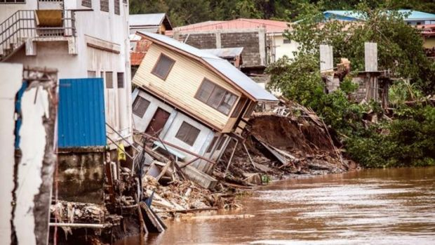 Houses fell into the Matanikau River as a result of the flooding.