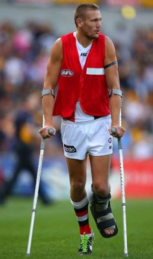 Sam Gilbert heads to the change rooms on crutches at the half-time break during the match against West Coast on Saturday.