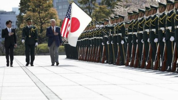 Japan's Defence Minister Itsunori Onodera (left) and US Secretary of Defence Chuck Hagel (right) review honour guards at ...
