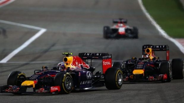 Under pressure: Ricciardo leads his teammate Sebastian Vettel on the track.