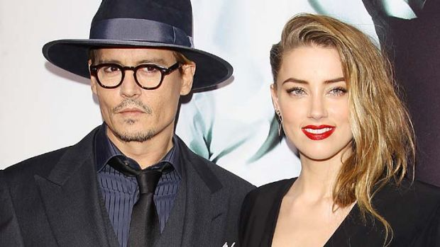 Newly engaged: Amber Heard and Johnny Depp in February this year.
