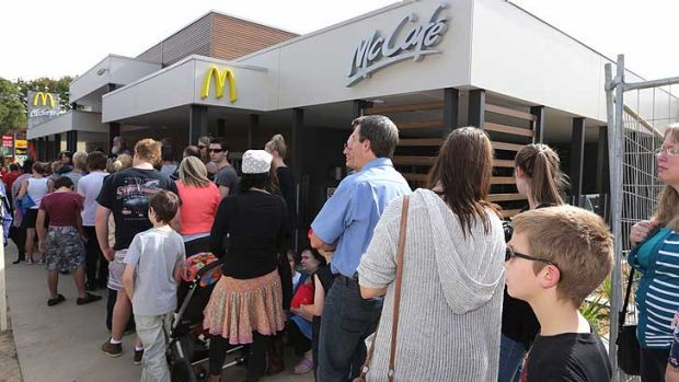 Protesters against the McDonald's franchise were outnumbered by queuing fans.