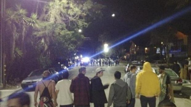 A crowd confronting police at a disturbance during a weekend college party in Southern California that devolved into a ...