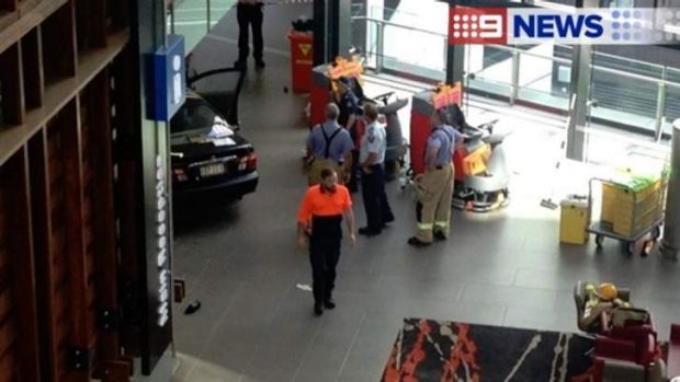 Emergency workers at the scene where a car crashed into the Gold Coast University Hospital foyer.