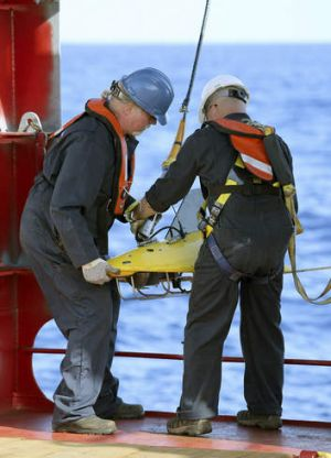 Crew on the Ocean Shield deploy a towed pinger locator in an attempt to find the black box.