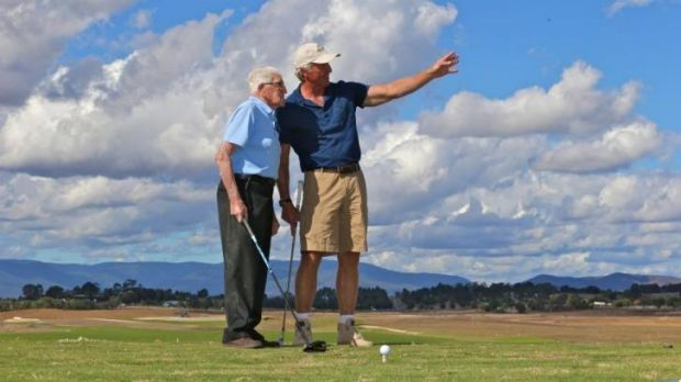 On course: Les Smith, 99,  hitting a ceremonial opening tee shot alongside Greg Norman at the new Eastern Golf Club.