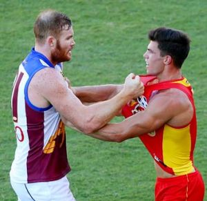 Daniel Merrett of the Lions and Jaeger O'Meara of the Giants get to grips with each other.