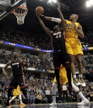 Indiana Pacers forward David West fights for a rebound with Miami Heat forward Udonis Haslem in Indianapolis. The Pacers ...