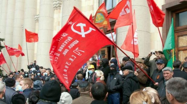 Uprising: Pro-Russian activists wave communist flags during a rally in the eastern Ukrainian city of Kharkiv.