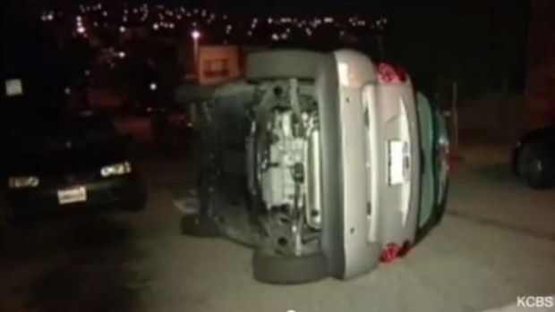 One of three Smart cars that were tipped over by vandals in San Francisco on Sunday night.