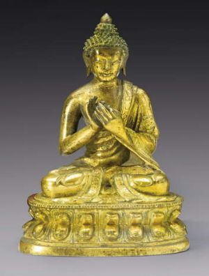 A gilt bronze figure of Buddha from the Qing dynasty, 18th century.