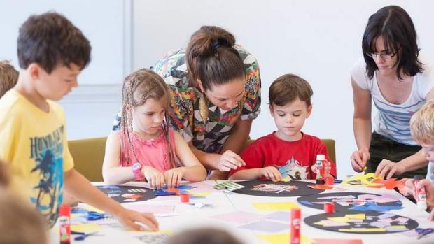 Jemima Wyman with young visitors participating in a children's art centre activity trail at GoMA.