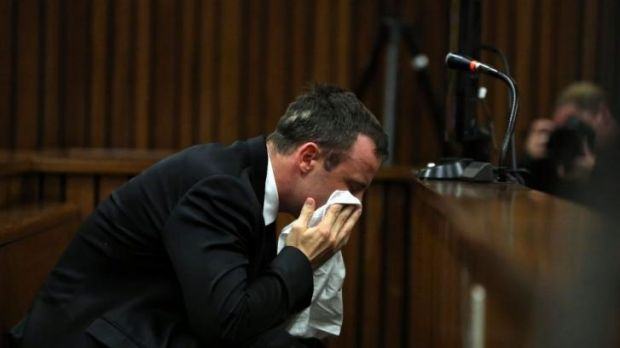 Overwrought: South African Paralympic star Oscar Pistorius wipes his face during his trial in Pretoria.